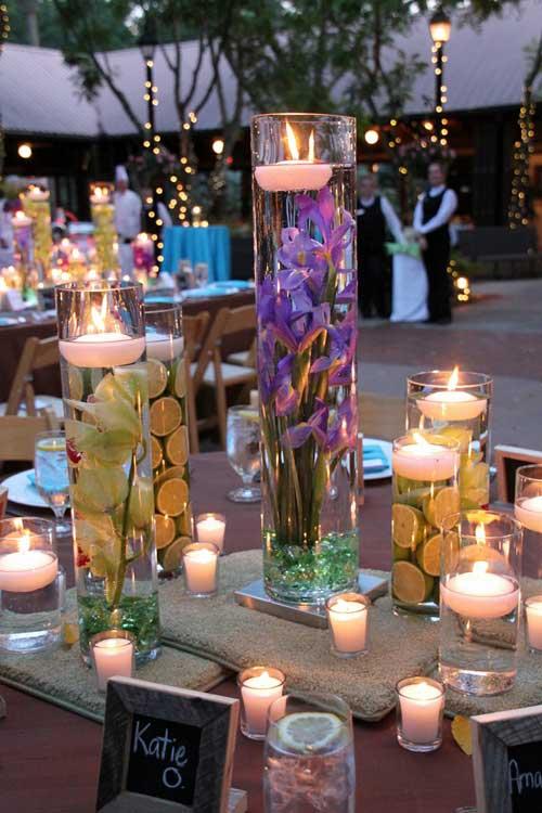diy decoratie drijfkaarsen in vazen bruiloft inspiratie