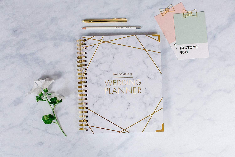 Bruiloft planner met pennen